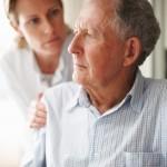 nurse-comforting-a-worried-senior